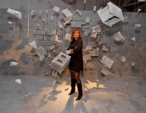 Francesca van Habsburg with the installation Frío Estudio del Desastre, 2005, by Los Carpinteros, cinder blocks, concrete, fishing nylon, dimensions site-specific.