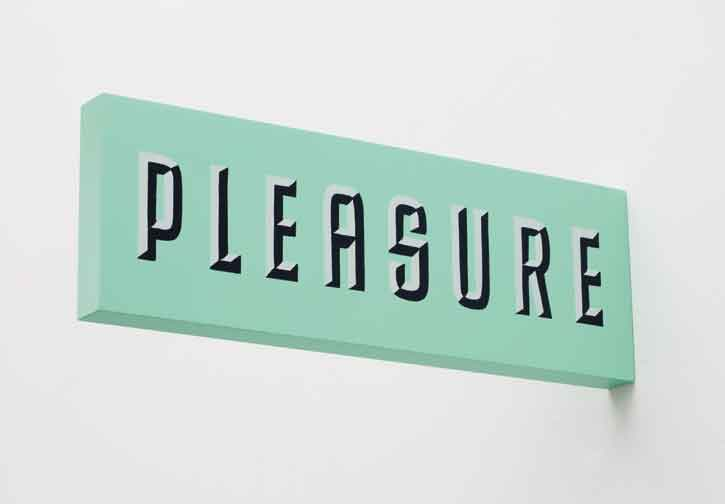 "Matthew Brannon, Pleasure / Guilty, 2011, wood, metal enamel, 5.5"" x 16.5"" x 1.4"". ©Matthew Brannon. Courtesy of the artist and Casey Kaplan Gallery, New York. Photo Credit: Cathy Carver."