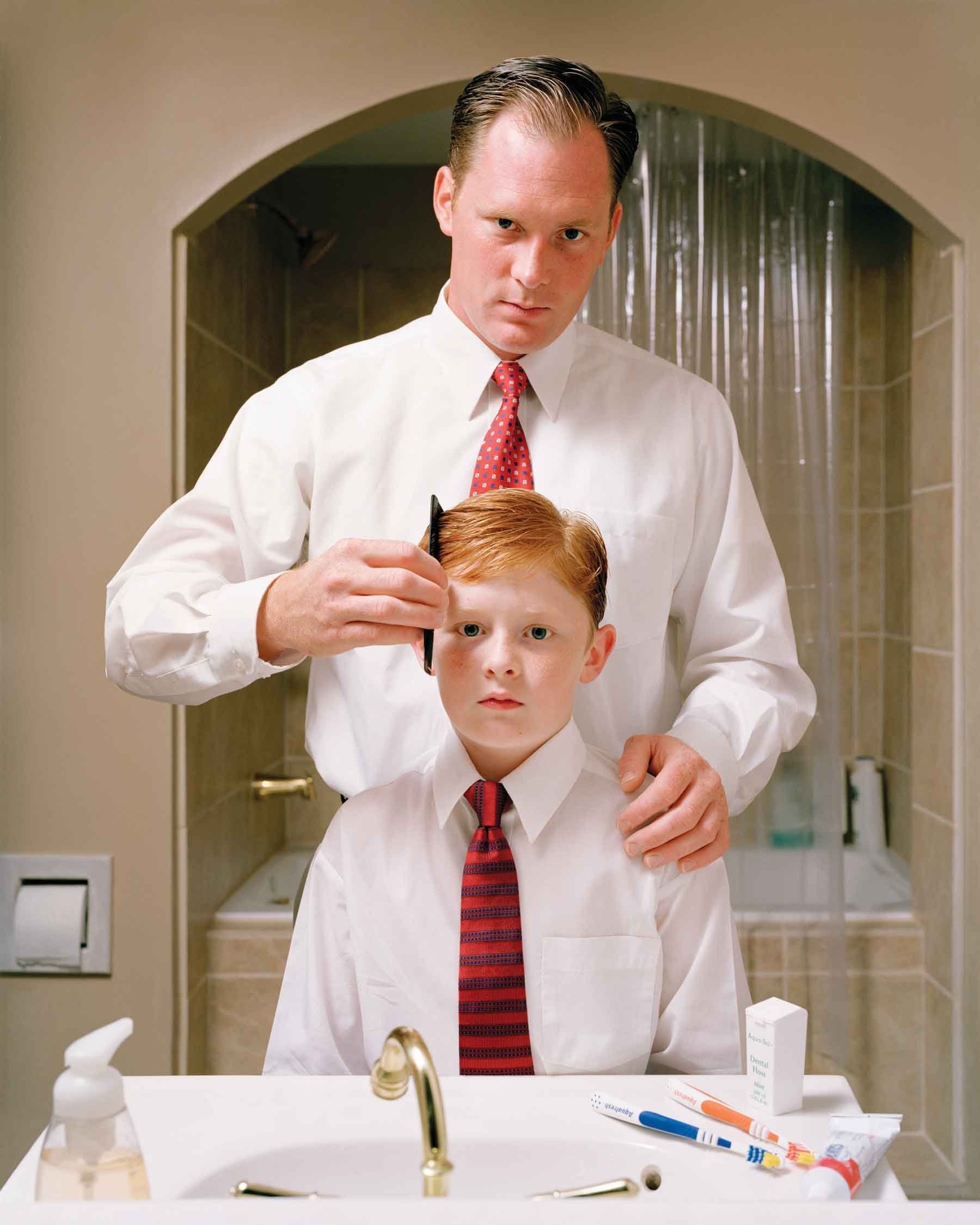 "Angela Strassheim, Untitled (Father and Son), 2004, C-print, 40"" x 30"", (From The Left Behind series)"