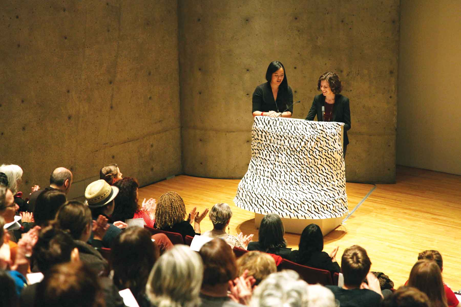 Audrey Chan and Elana Mann, organizers of Shares and Stakeholders: The Feminist Art Project Day of Panels at the 100th Annual College Association Conference, Museum of Contemporary Art, Los Angeles, 2012. Podium skirt designed by CamLab. Photo: Jean-Paul Leonard.