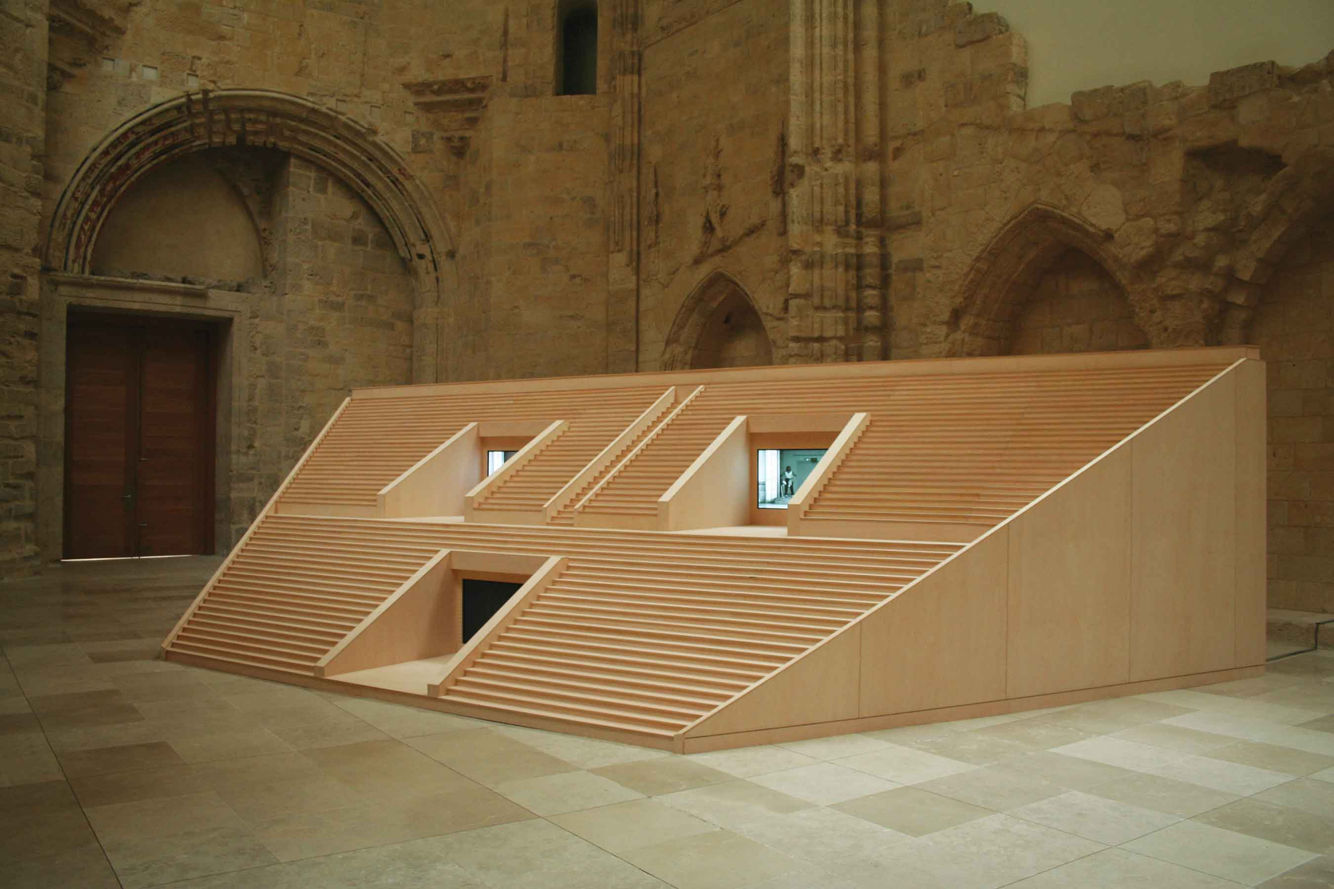 Perpetual Free Entrance, 2006, wood, three plasma TVs, video and audio installation, 36' x 13' x 8'