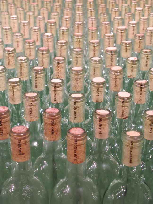 Elida Tessler, Dubling, 2010, mixed-media installation consisting of 4311 wine bottles with corks, and a special table that contains 4311 postcards. Courtesy of the artist and CIFO, Cisneros Fontanals Art Foundation, Miami, FL.