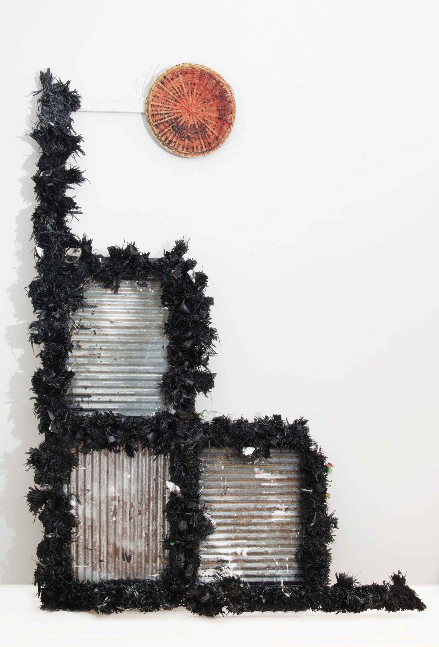 """Rosy Keyser, A Blind Torpedo Walks into a Bar, 2013, raffia, enamel, glass, wood, and basket, 91 ½"""" x 65 ½"""". Courtesy Peter Blum Gallery, New York."""
