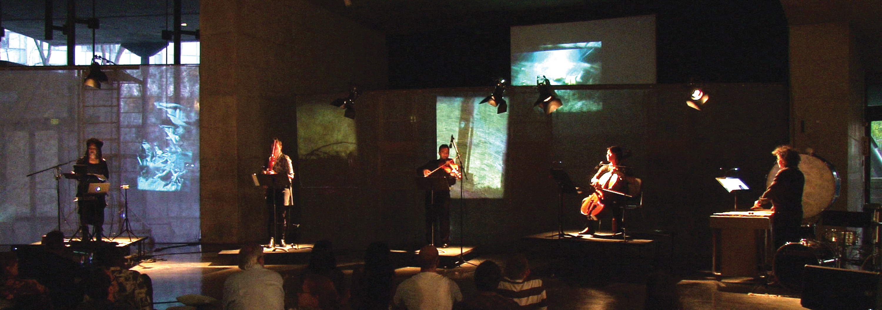 Carbon Song Cycle. From left to right: Pamela Z (voice & electronics), Dana Jessen (bassoon), Charith Premawardhana (viola), Theresa Wong (cello), Suki O'Kane (percussion) with Christina McPhee's video work in the background. Photo: Silvia Matheus.