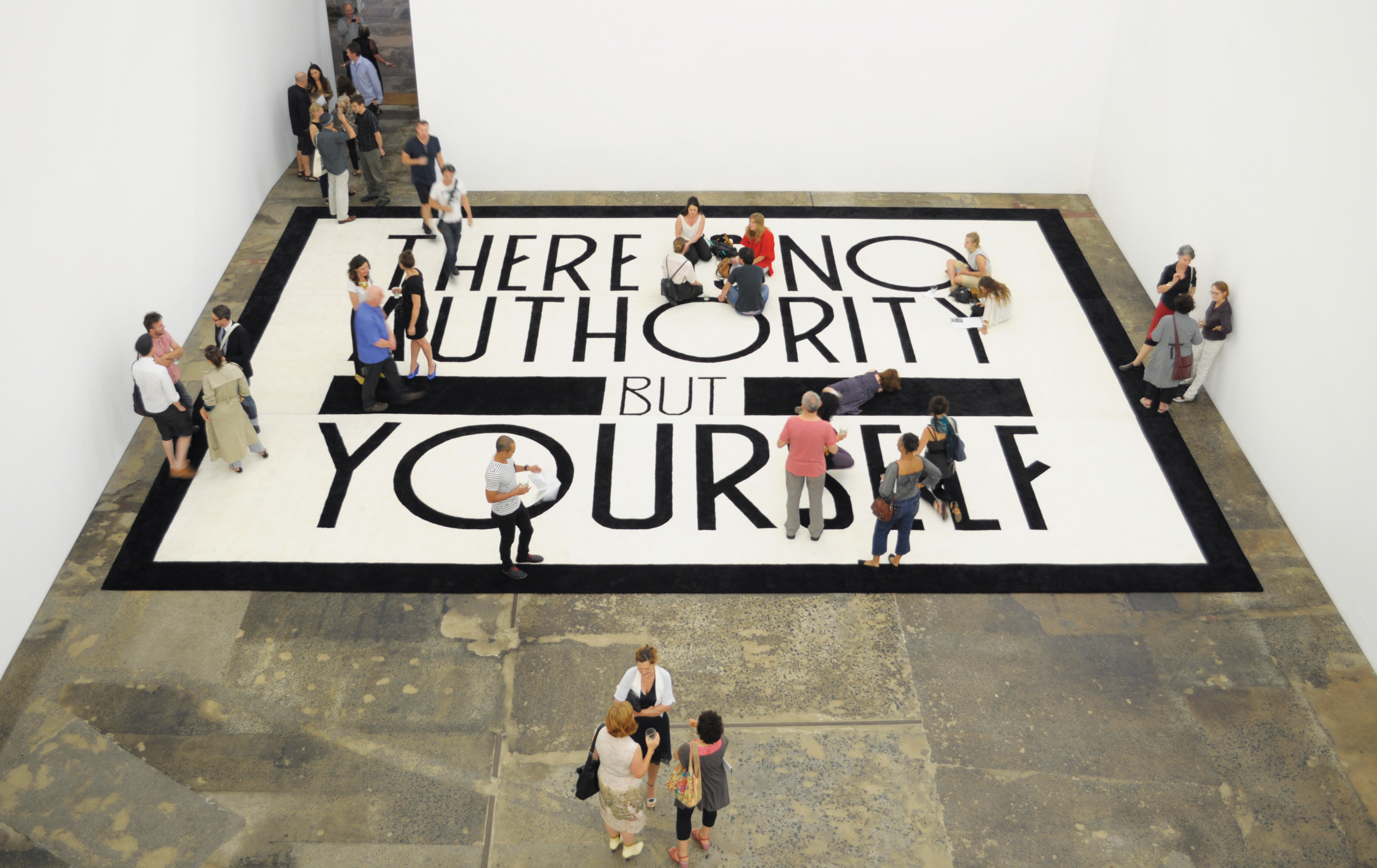 Marco Fusinato, THERE IS NO AUTHORITY, 2012, 100% New Zealand wool rug, monitor, camera, 30' x 39' Installation view at Anna Schwartz Gallery, Sydney. Lyon Housemuseum Collection.