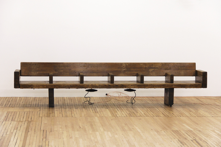 "Sergei Tcherepninm, Motor-Matter Bench, 2013, wood subway bench, transducers, amplifier, HD media player, 28.5"" x 20.5"" x 126.5"". Image courtesy of Murray Guy, New York. Photo: Fabiana Viso."