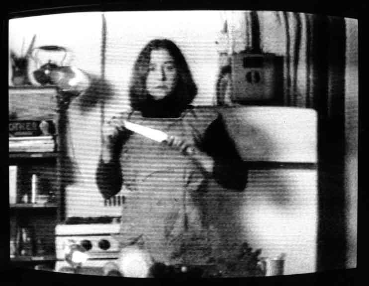 Martha Rosler, Letter K, Knife, from Semiotics of the Kitchen, black-and-white video, 1975.