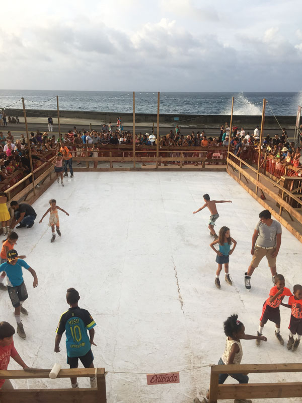 "Duke Riley, La Esquina Fría del Malecón, 2015. ""Detrás del Muro"" project, Havana Biennial. Cuban kids skate on 'ice' for the first time.  A handful of old-timers remember past attempts to introduce ice skating into Cuba. Photo: Victor J. Webster."