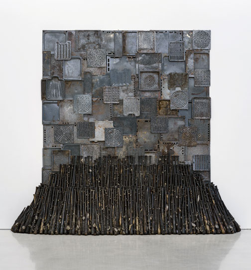 "Nari Ward, Iron Heavens, 1995, oven pans, ironed cotton, and burnt wooden bats, 140 x 148"" x 48."" Installation view at Pérez Art Museum Miami, 2015. Courtesy Pérez Art Museum Miami. Photo: STUDIO LHOOQ."
