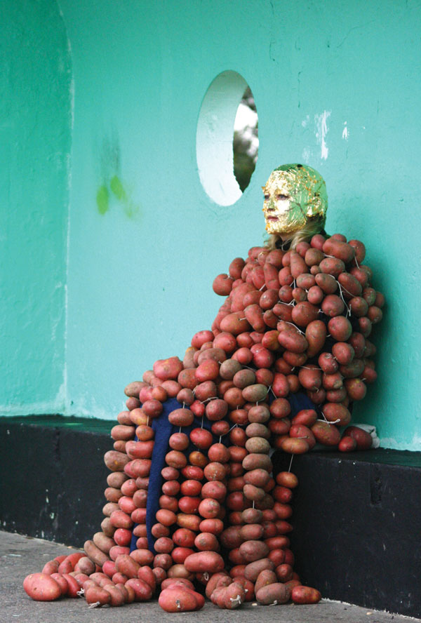 Amanda Coogan, How to Explain the Sea to an Uneaten Potatoe, photographic still from live performance at The Bull Walk, Clontarf, Dublin, Duration 4 hours. Photo: Damien McGlynn. Courtesy of the artist and Kevin Kavanagh Gallery, Dublin.