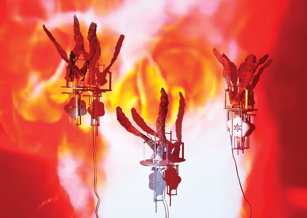 Carolee Schneemann, Flange 6rpm, 2011-13, installation view, foundry poured aluminum sculptures, motors 6 rpm each unit, 7 units, 9' x 20' x 3.' Courtesy of the Art Matters Foundation. Photo: Susan Alzne.