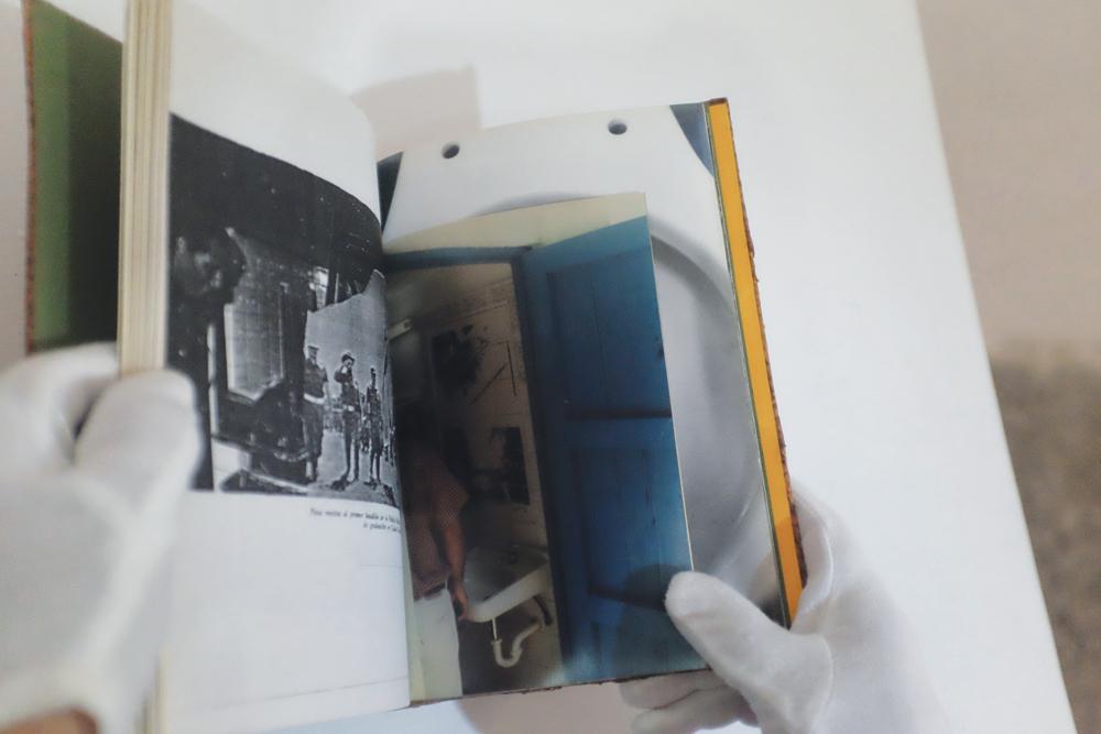 "Henry Eric Hernández, A fuerza de souvenir (I), 2000-2001, book (7.48"" x 9.44""), table, gloves, chronology."