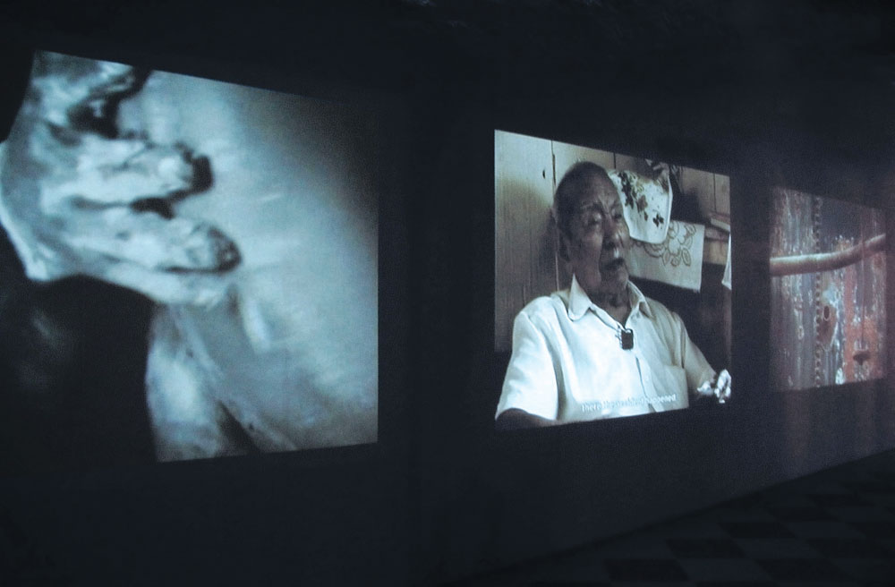 Tomás Ochoa, SAD CO. The Blind Castle, 2003, video, three channel, color, sound, 25 min. 44 sec., installation view.