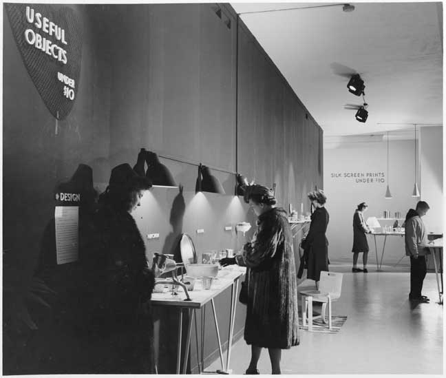 "Visitors at the exhibition ""Useful Objects of American Design under $10,"" on view at The Museum of Modern Art, New York, November 26–December 24, 1940. The Museum of Modern Art Archives, New York."