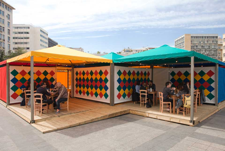 Rasheed Araeen, Shamiyaana—Food for Thought: Thought for Change, 2016–17, canopies with geometric patchwork, cooking, and eating, Kotzia Square, Athens, documenta 14. Photo: Yiannis Hadjiaslanis.