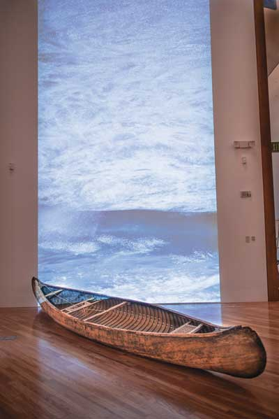 Humberto Castro, Tracing Antilles, 2013, installation with wooden canoe and video, dimensions variable. Courtesy of the artist.